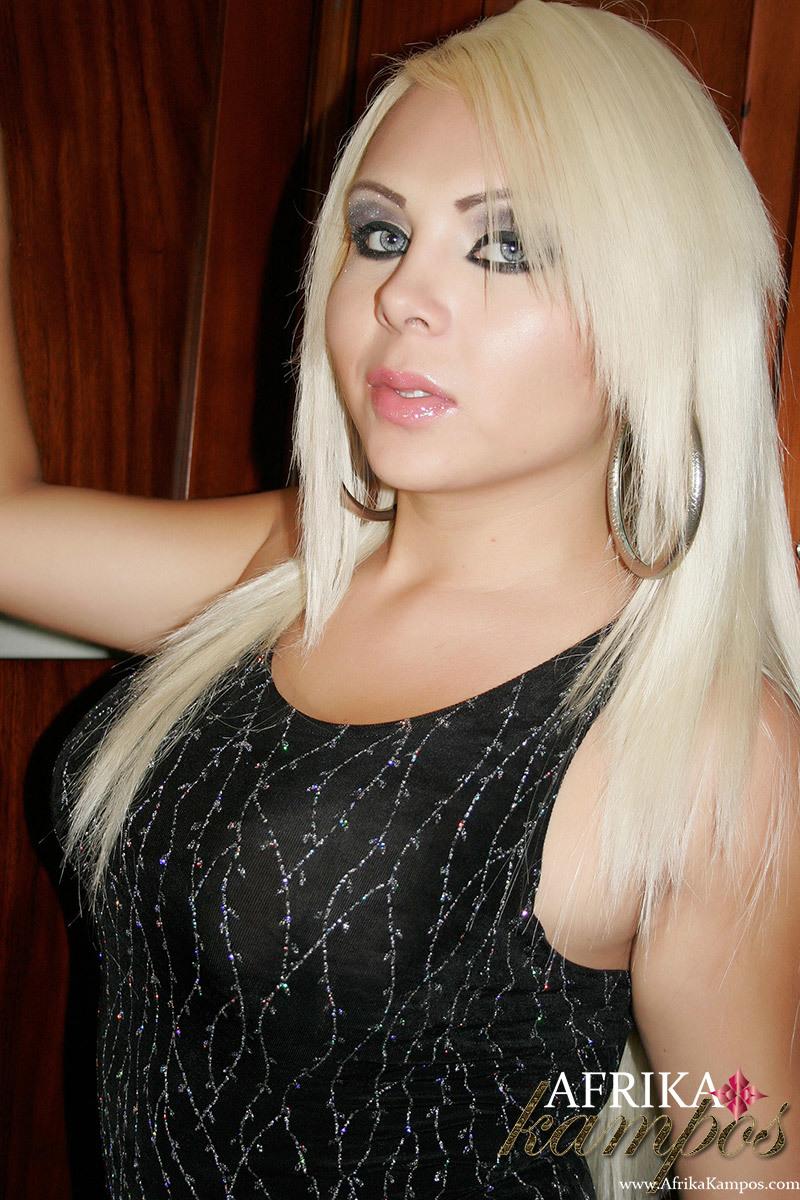 Elegant Blonde Transexual Has An Erect Uncut Tool