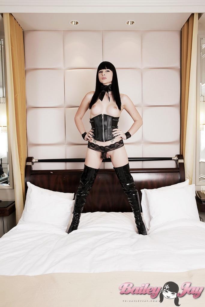 Smoking Seductive TS Babe Posing In Sensuous Black Long Boots