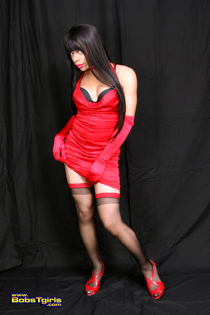 TS Sasha Posing In Sexy Red Skirt Black Stockings